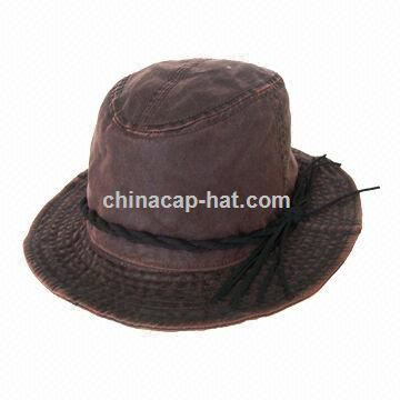 Brown fishing hat, decorated with queue tape